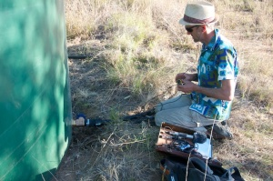 Boyd recording at the water tank on Bimblebox Nature Refuge, September 2012. Photo courtesy of Alison Clouston