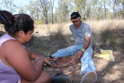 Howard and Sarah Butler, making a coolamon on Bimblebox Nature Refuge, September 2012.