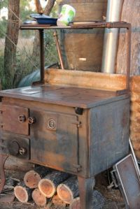 The old stove for cooking, night time warmth and the water heater. photo by Jill Sampson