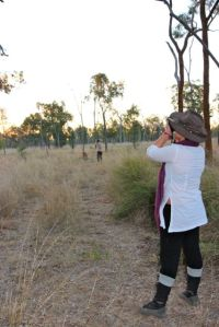Zena taking photos as the sun sets