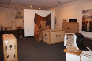 Crates fill the gallery.