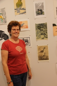 Artist Glenda Orr with her artwork for the Bush Stone Curlew (lower right), photo Jill Sampson