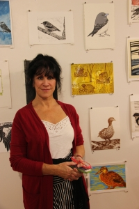 Artist Linda Douglas with her artwork for the Red-chested Button Quail photo Jill Sampson