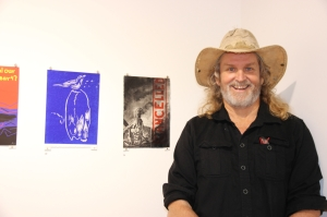 Gerald Soworka wiht his artwork at the opening of Bimblebox 153 birds, photo Jill Sampson.