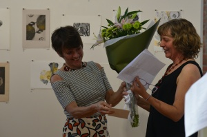 Alison Clouston presents Jill Sampson with a boquet of beautiful flowers in thank you for the Bimblebox Art Project and Bimblebox 153 Birds. photo Jennifer Eurell.