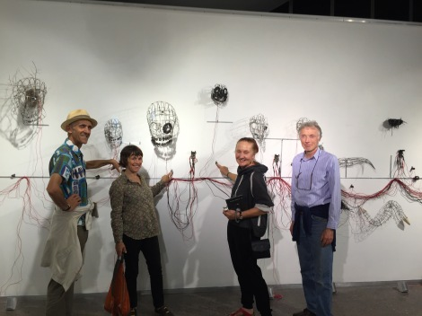 Artists Boyd and Alison Clouston (left) with their artwork 'Carbon Dating' and their friends at the exhibition opening.
